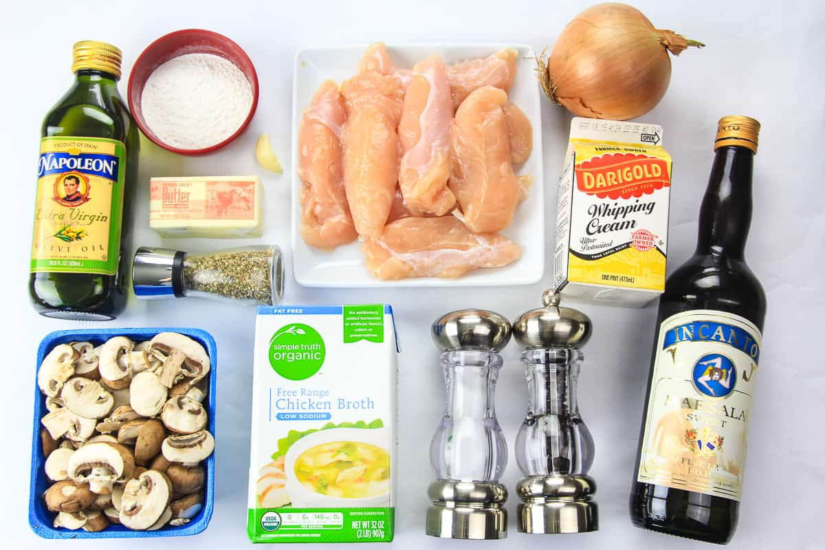 overhead image of ingredients for homemade chicken marsala on a white background