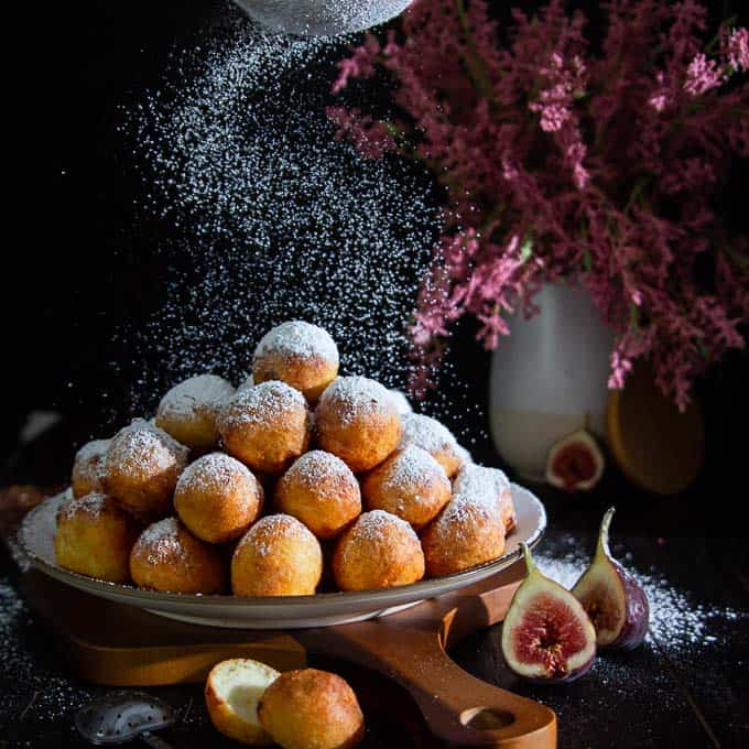 Doughnut holes with powdered sugar