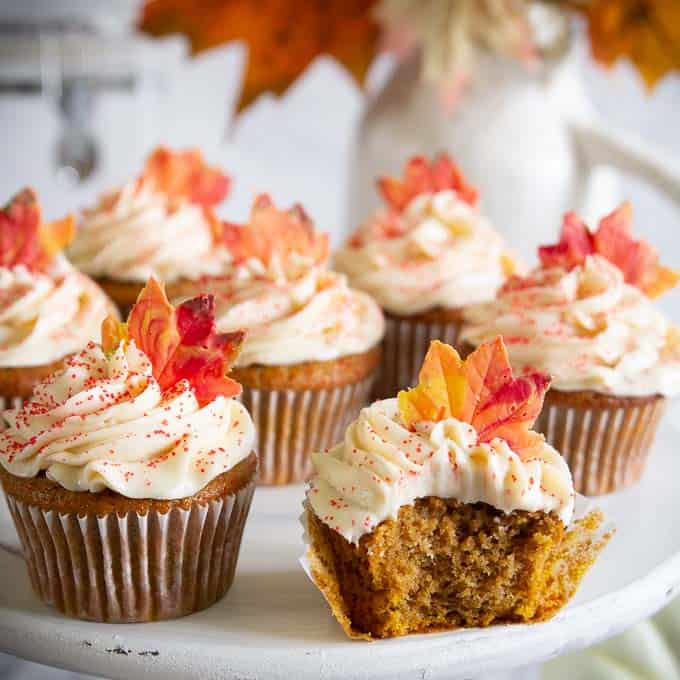 pumpkin cupcakes with cream cheese frosting and candy leaf topper