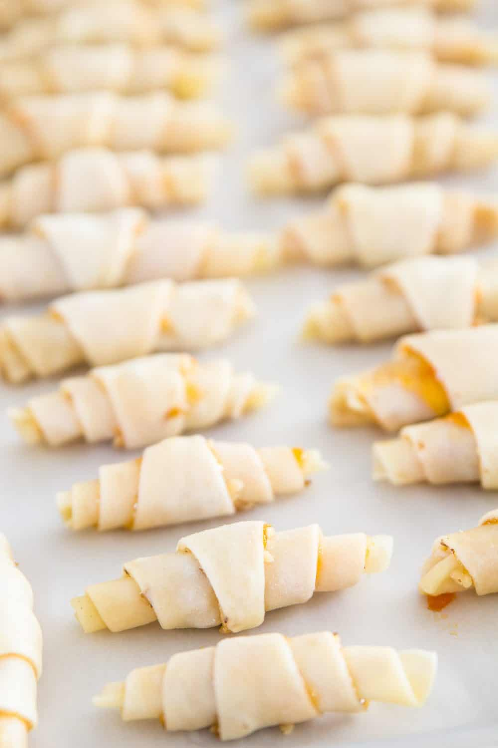unbaked rugelach cookies on a baking sheet