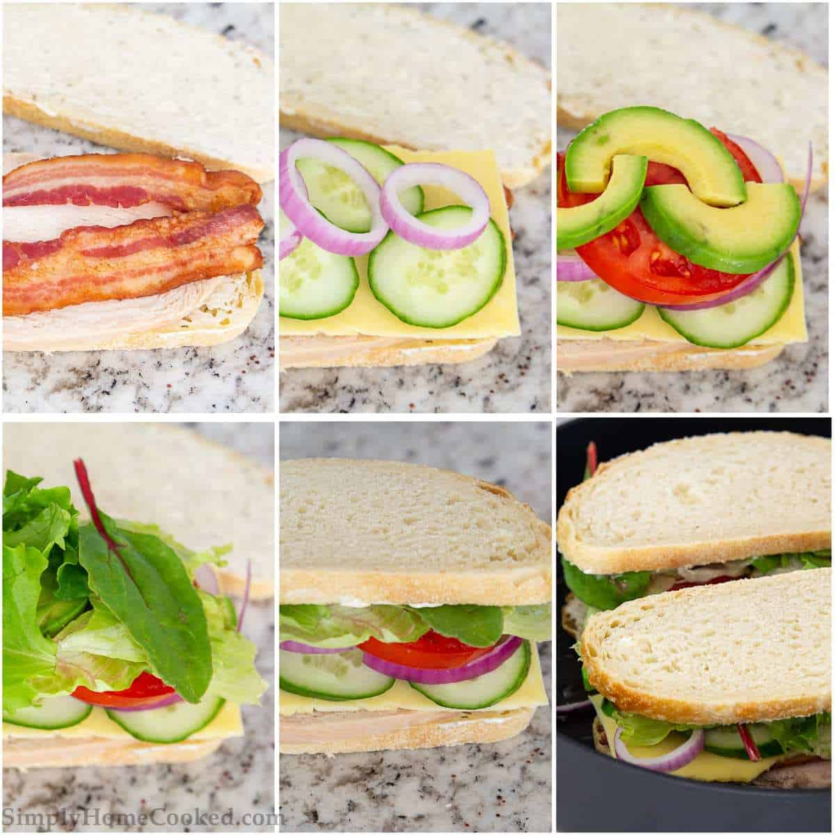 sliced sourdough bread with bacon, cucumbers, red onion, avocado, tomatoes, and lettuce on top