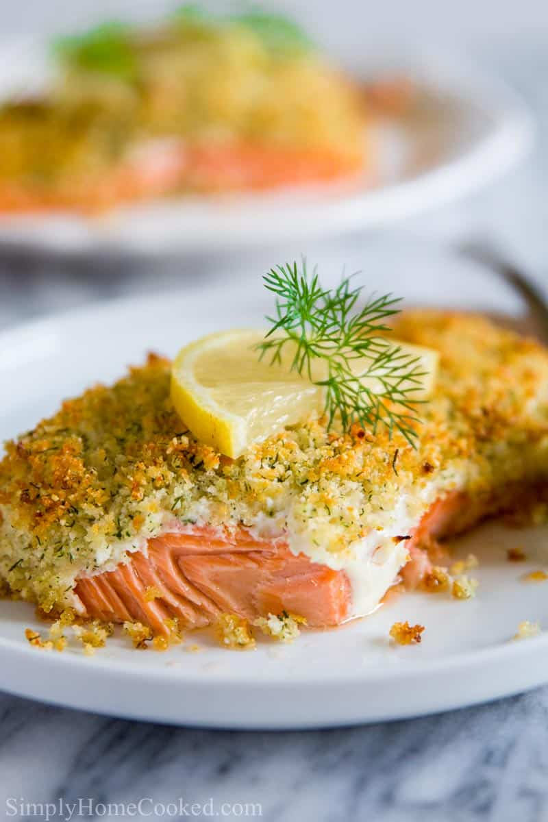 close up image of panko crusted salmon with lemon and dill on top
