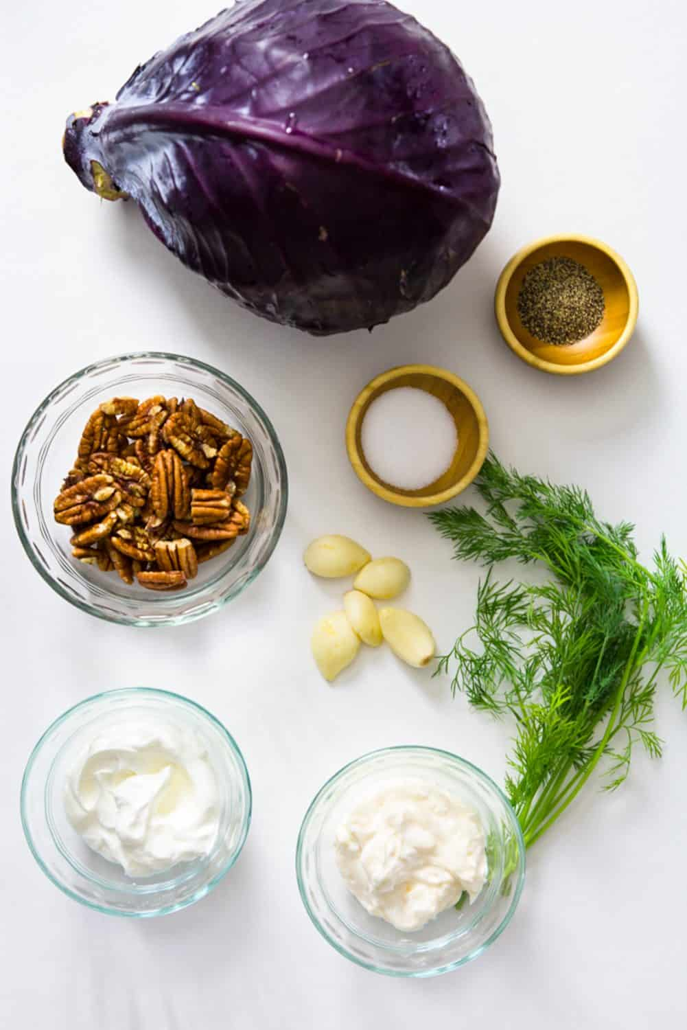 Red Cabbage Salad ingredients - Mayo, sour cream, pecans, salt, pepper, garlic, fresh dill, red cabbage