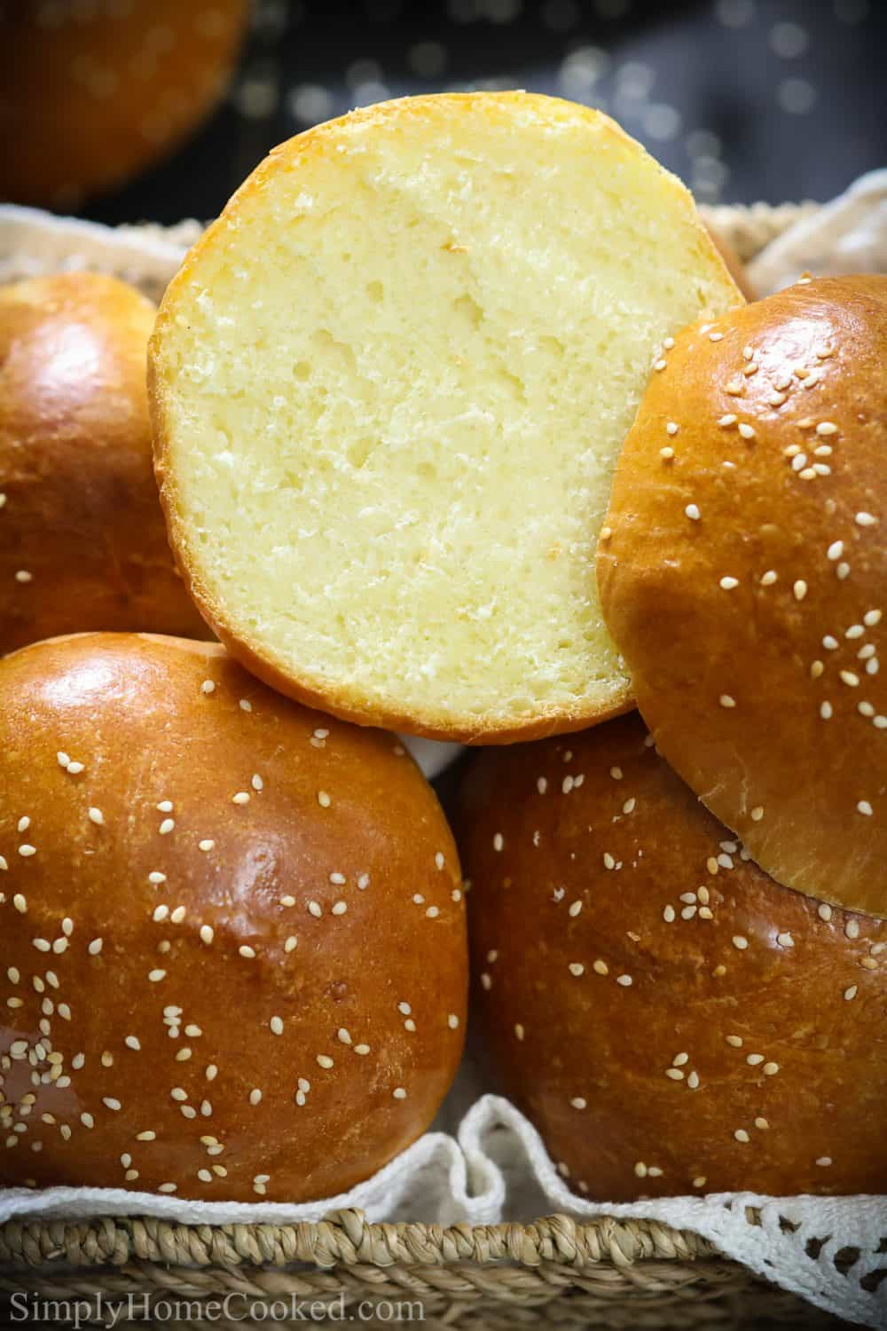 sliced brioche buns with sesame seeds on top