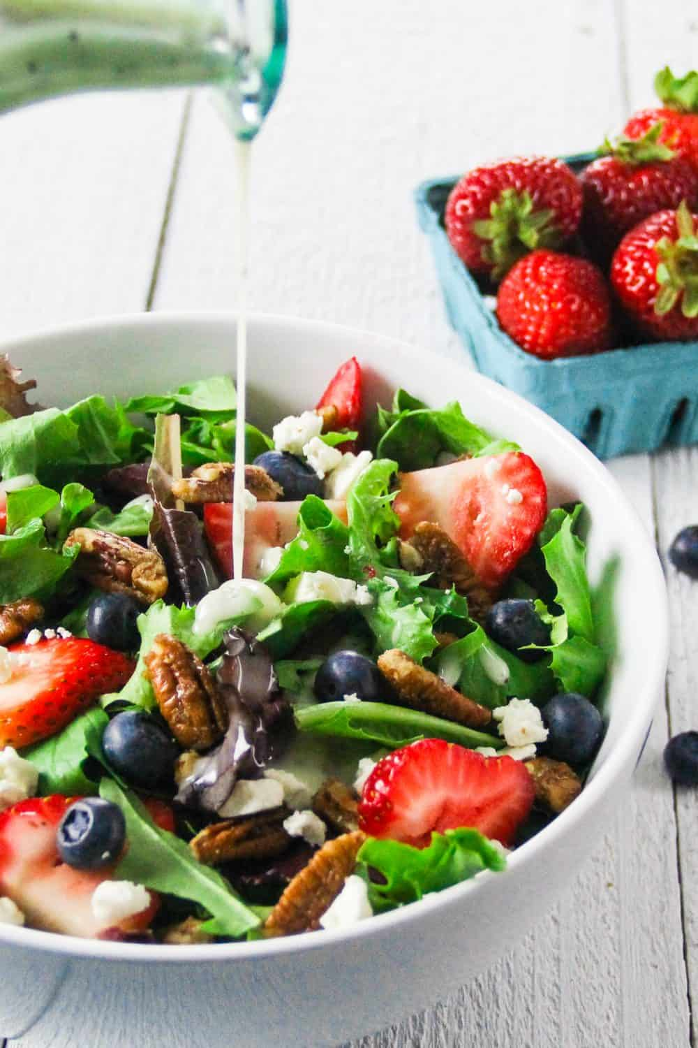 Add poppyseed dressing to this spinach strawberry feta salad recipe right before serving so your salad greens don't get soggy.
