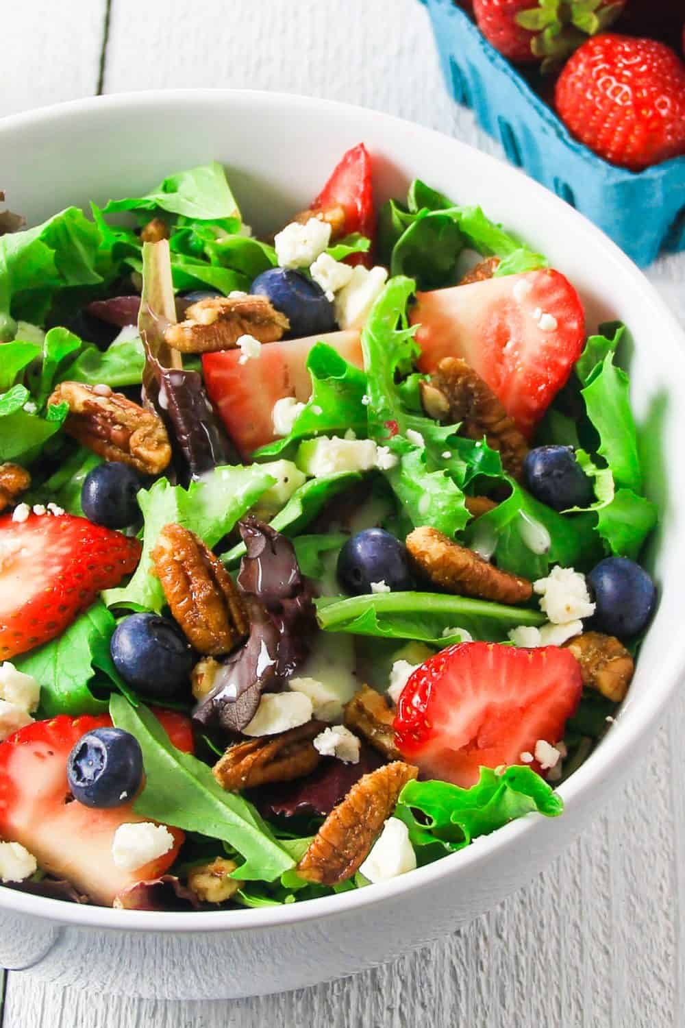 Spinach Strawberry Feta Salad is a wonderful bright salad that gives you tons of protein without feeling heavy. Make this as a full meal or a perfect side to your favorite grilled chicken recipe.