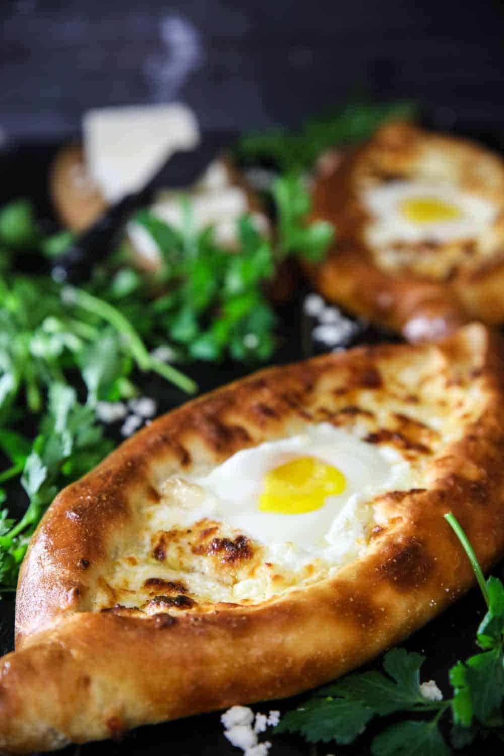 easy khachapuri made with pizza dough and an egg in the middle