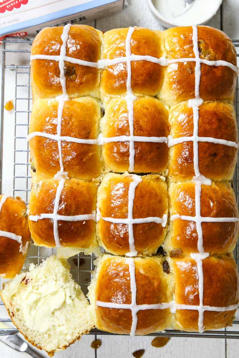 overhead image of brioche hot cross buns on a cooling rack
