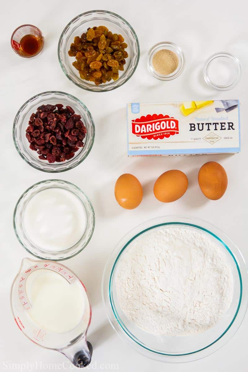 overhead image of ingredients for brioche hot cross buns on a white background