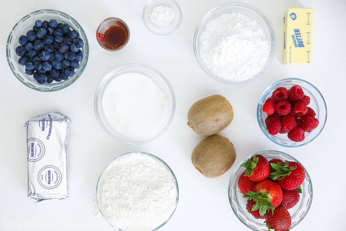 overhead shot of all the ingredients needed to make a fruit pizza