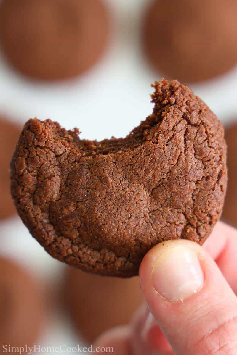 close up image of a hand holding a bitten Nutella cookie