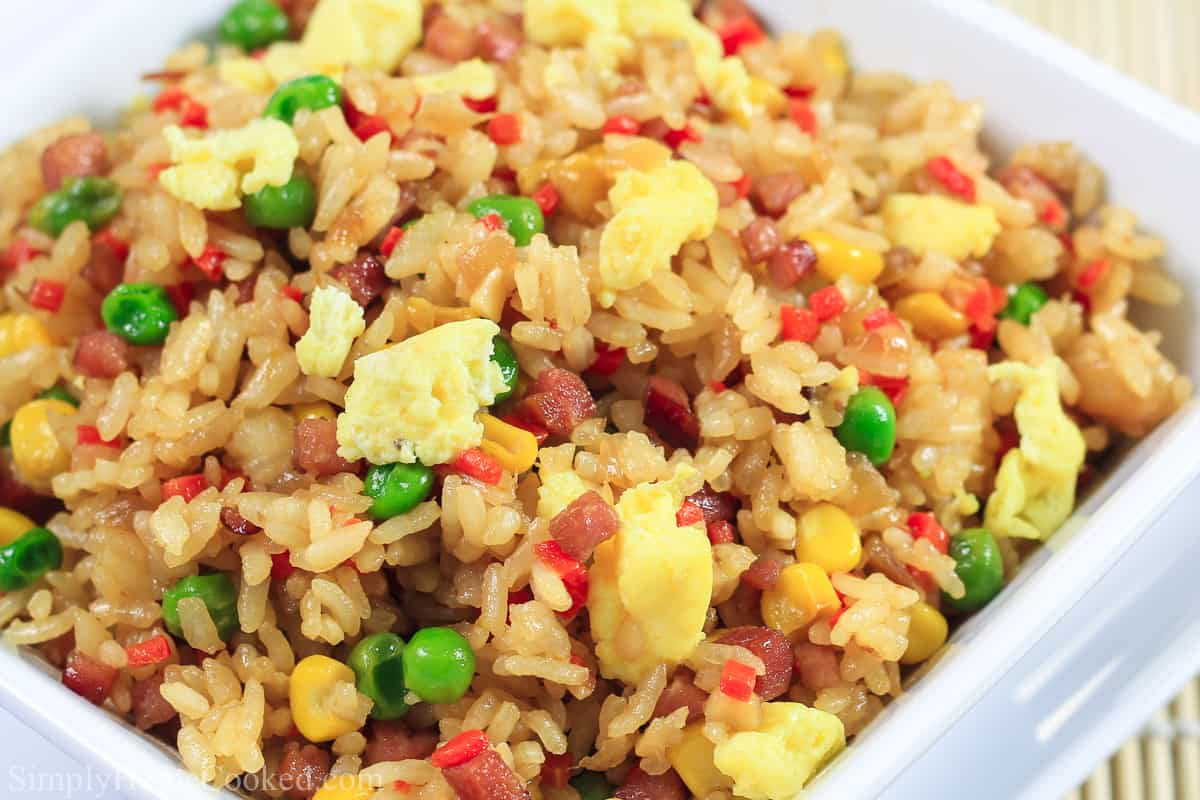 close up image of the best and most simple fried rice thats made with pork, peas, corn, carrot, and egg