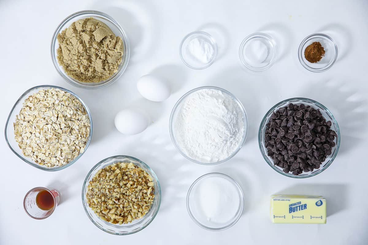 an overhead image of ingredients needed for oatmeal cookies with walnuts and chocolate chips