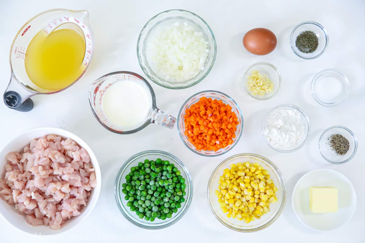an overhead image of ingredients for mini chicken pot pies on a white background
