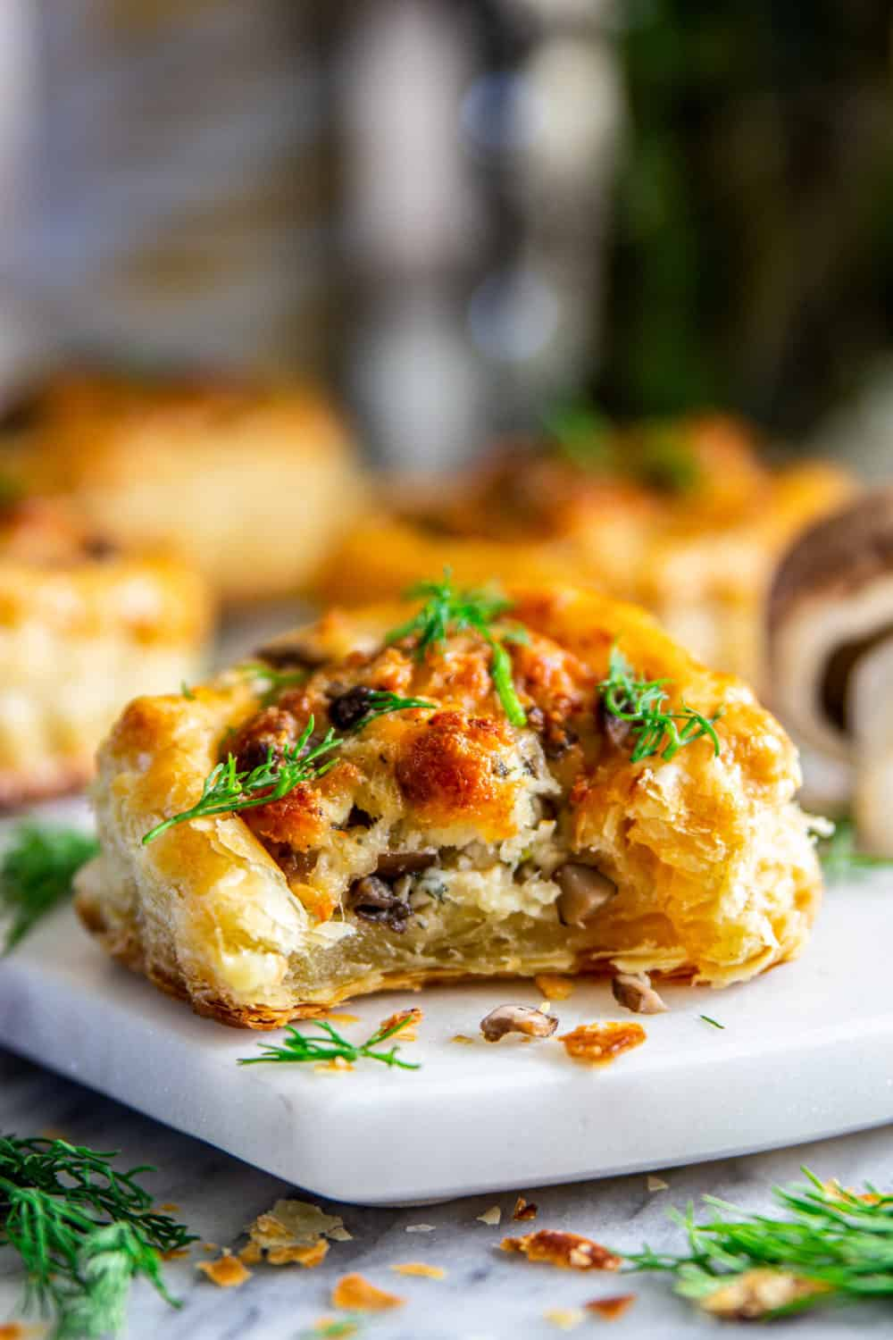 Mushroom Puff Pastry appetizer with more in the background.