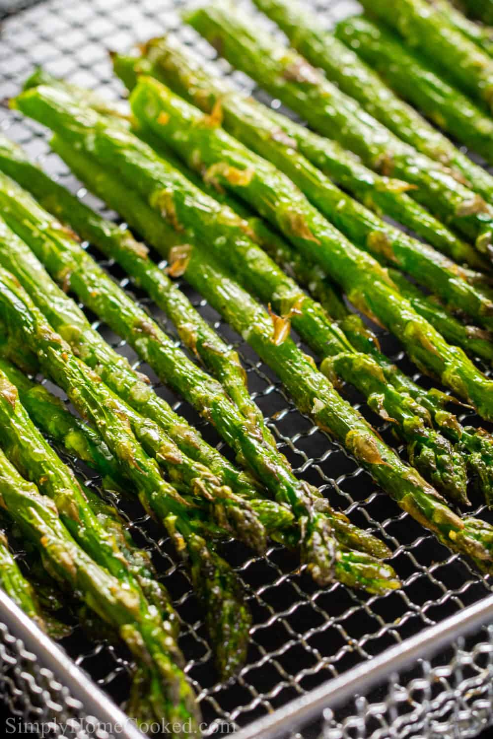 Asparagus spears lined up on a wire basket