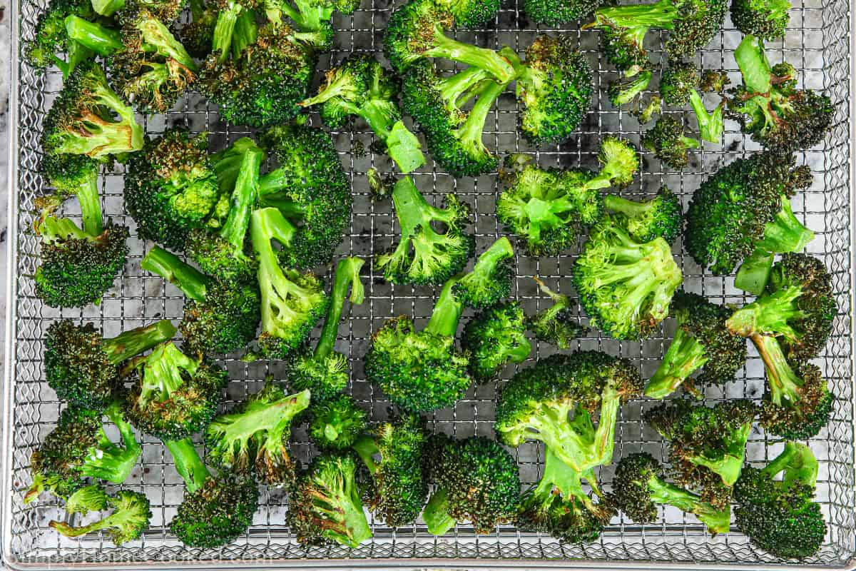 Basket full of Crispy Air Fryer Broccoli.