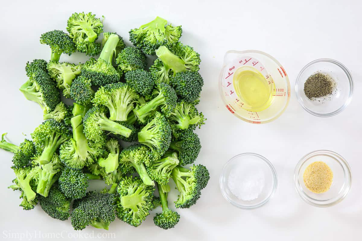Ingredients for crispy air fryer broccoli, including broccoli florets, olive oil, salt, pepper, and garlic powder.