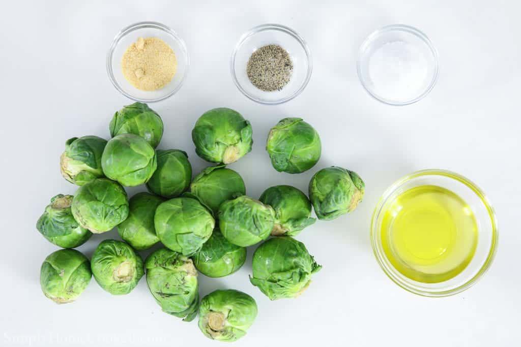 Ingredients for crispy brussels sprouts, including brussels sprouts, olive oil, salt, pepper, and garlic powder.