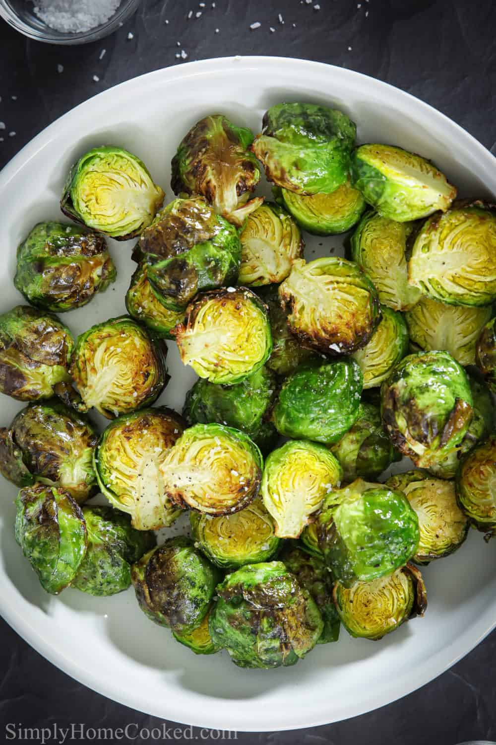 White plate of brussels sprout halves.