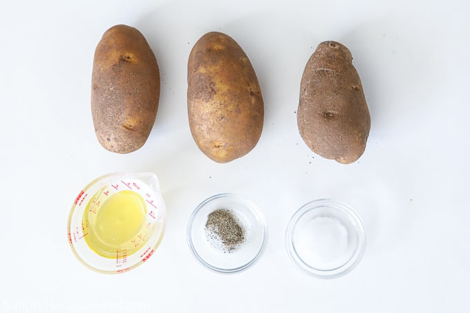 Ingredients for air fryer french fries, including potatoes, oil, salt, and pepper.