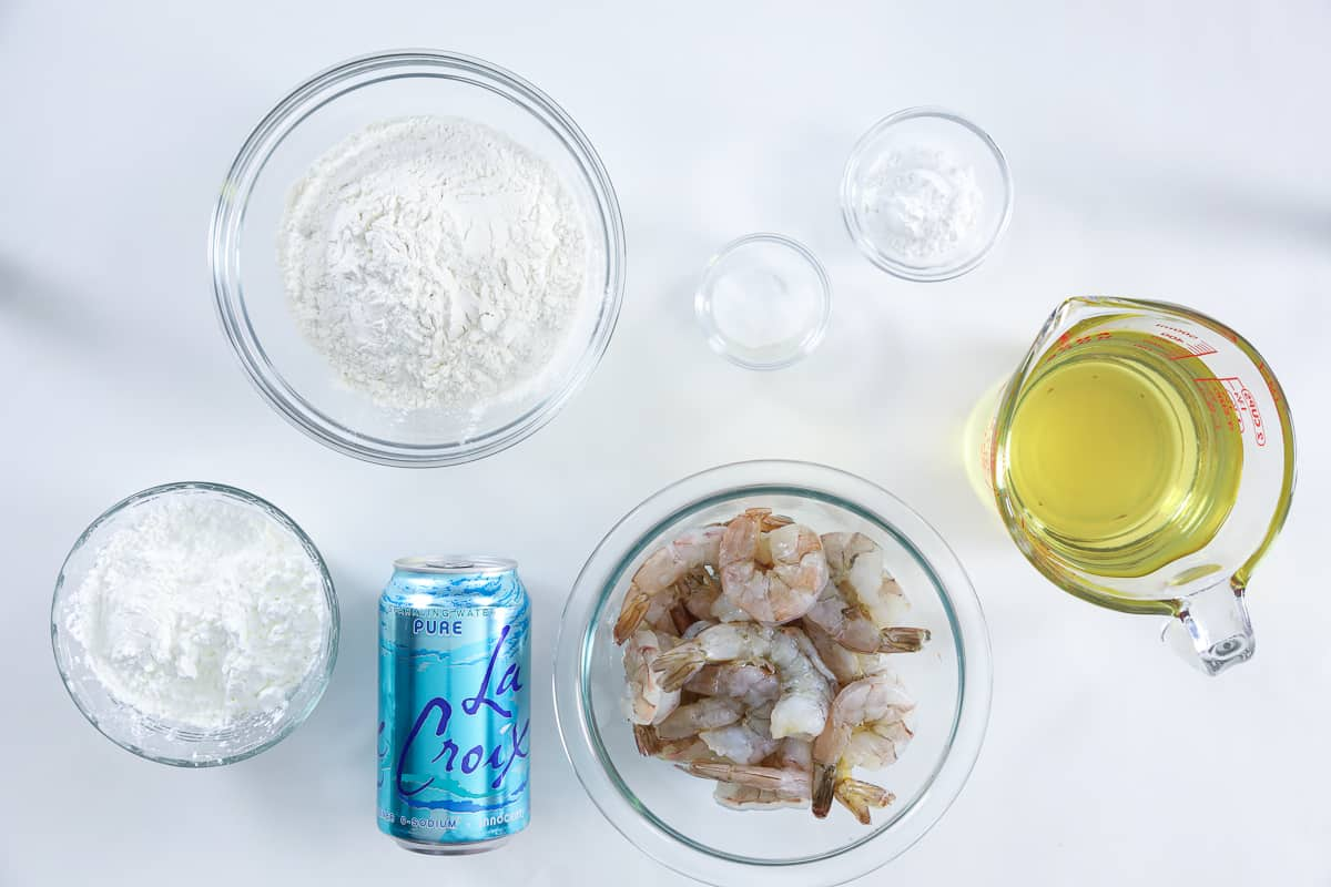 Ingredients for shrimp tempura batter, including flour, cornstarch, baking powder, salt, club soda, oil, and shrimp.