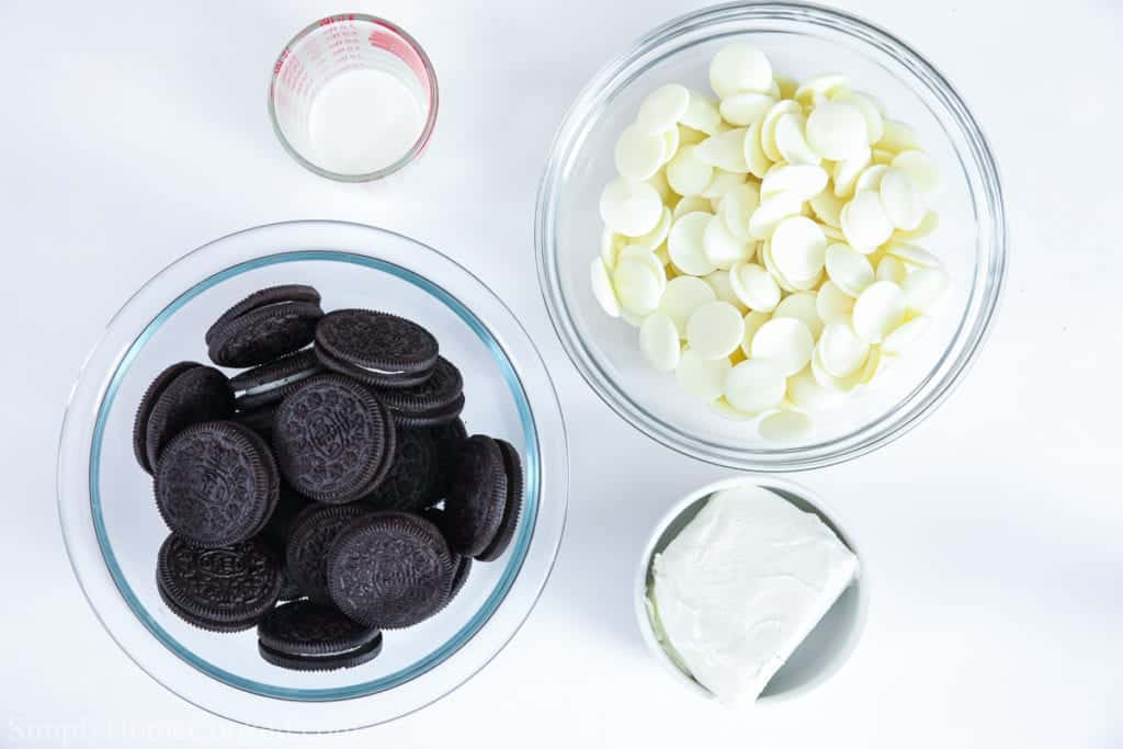 Ingredients for Oreo cake balls, including Oreo cookies, heavy cream, white candy melts, and cream cheese.