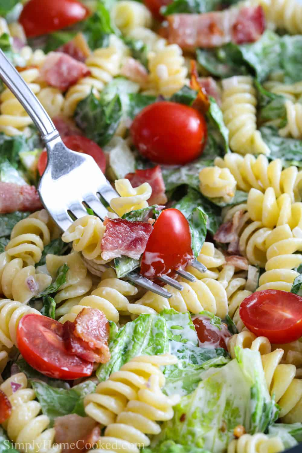 Close up of a fork dipping into a BLT Pasta Salad.