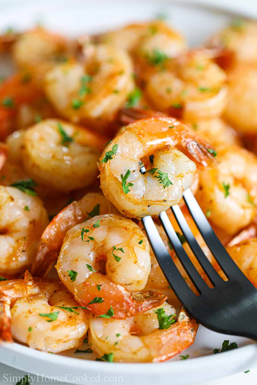 Close up of Air Fryer Shrimp, one shrimp speared on a fork.