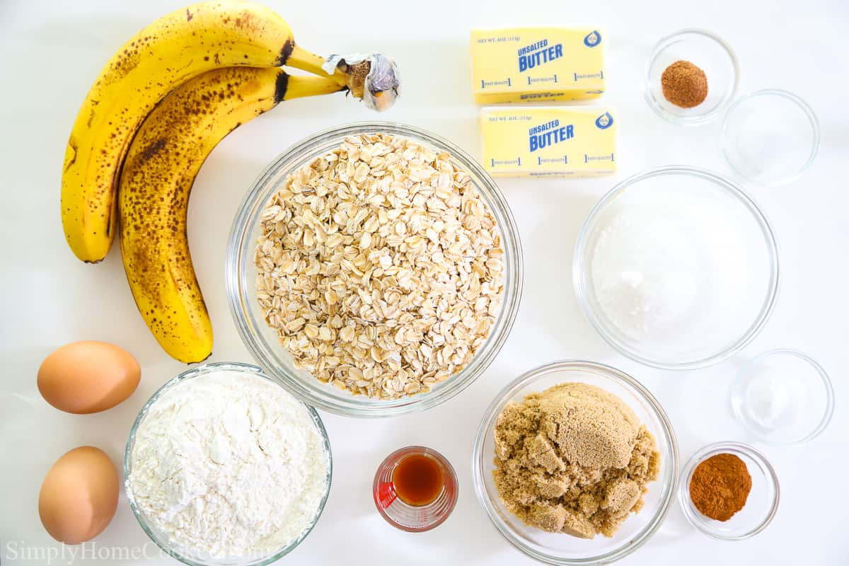 Ingredients to make Chewy Banana Oatmeal Cookies, including bananas, 2 eggs, butter, oats, sugar, brown sugar, vanilla, flour, cinnamon, salt, and mutmeg.