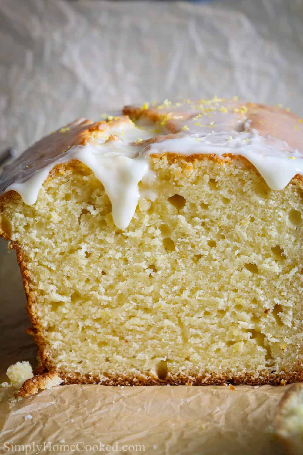 Close up of a loaf of Moist Lemon Pound Cake with lemon icing on top.