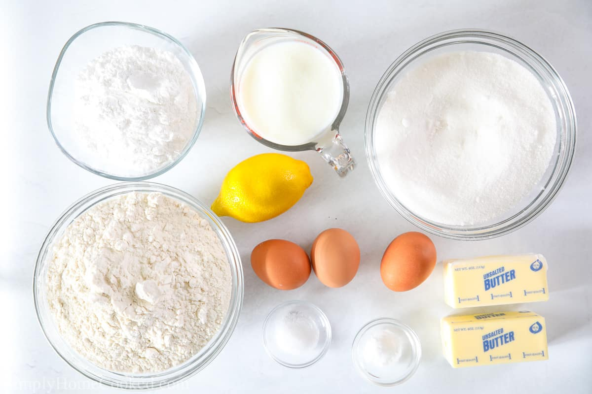 Ingredients for Moist Lemon Pound Cake, including flour, sugar,butter, buttermilk, baking soda, butter, salt, eggs, and lemon.