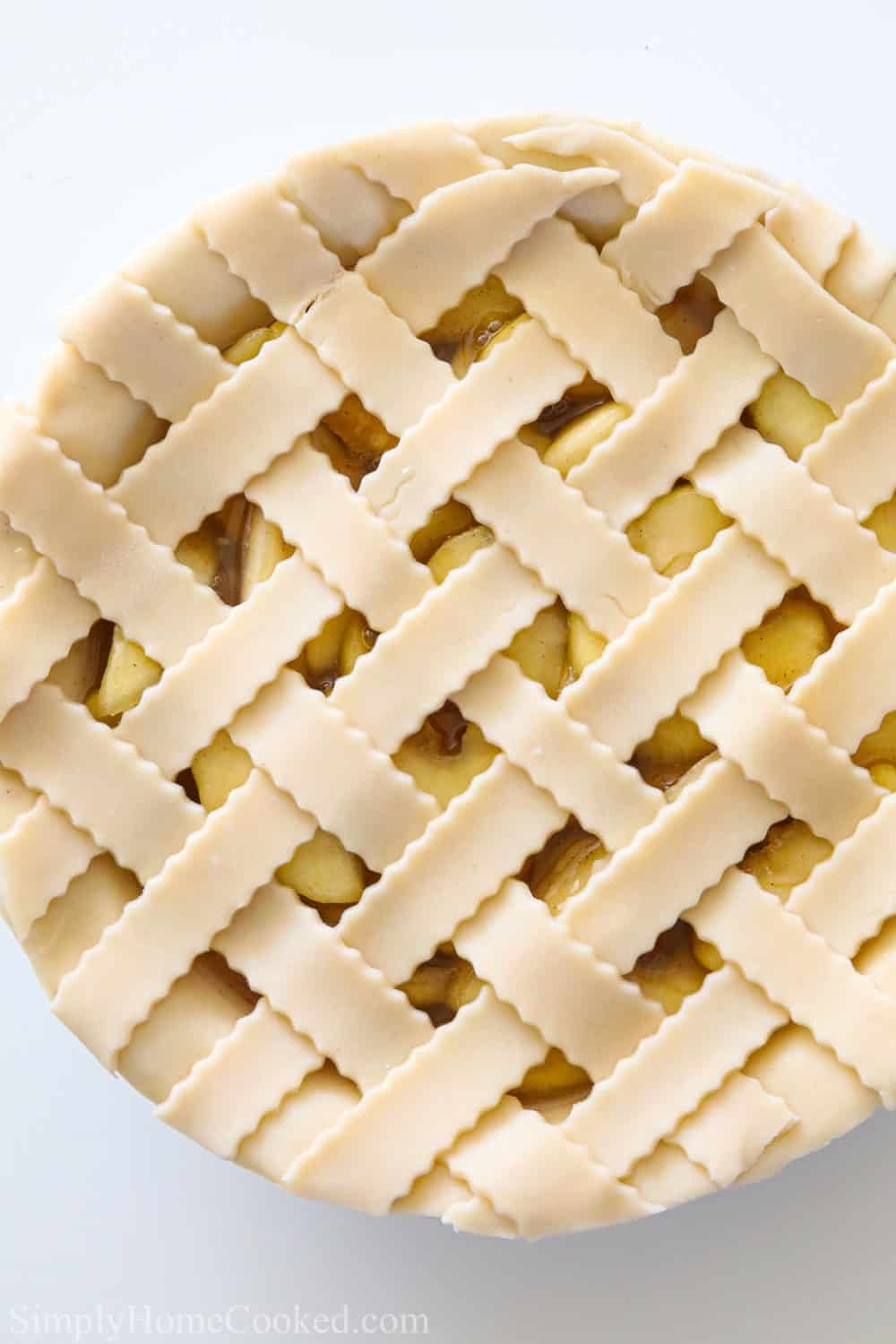 Latticed Homemade Apple Pie with a white background.