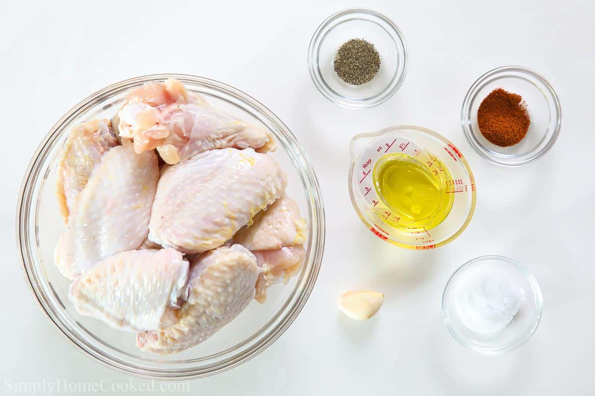 overhead image of air fryer chicken wing ingredients on a white background