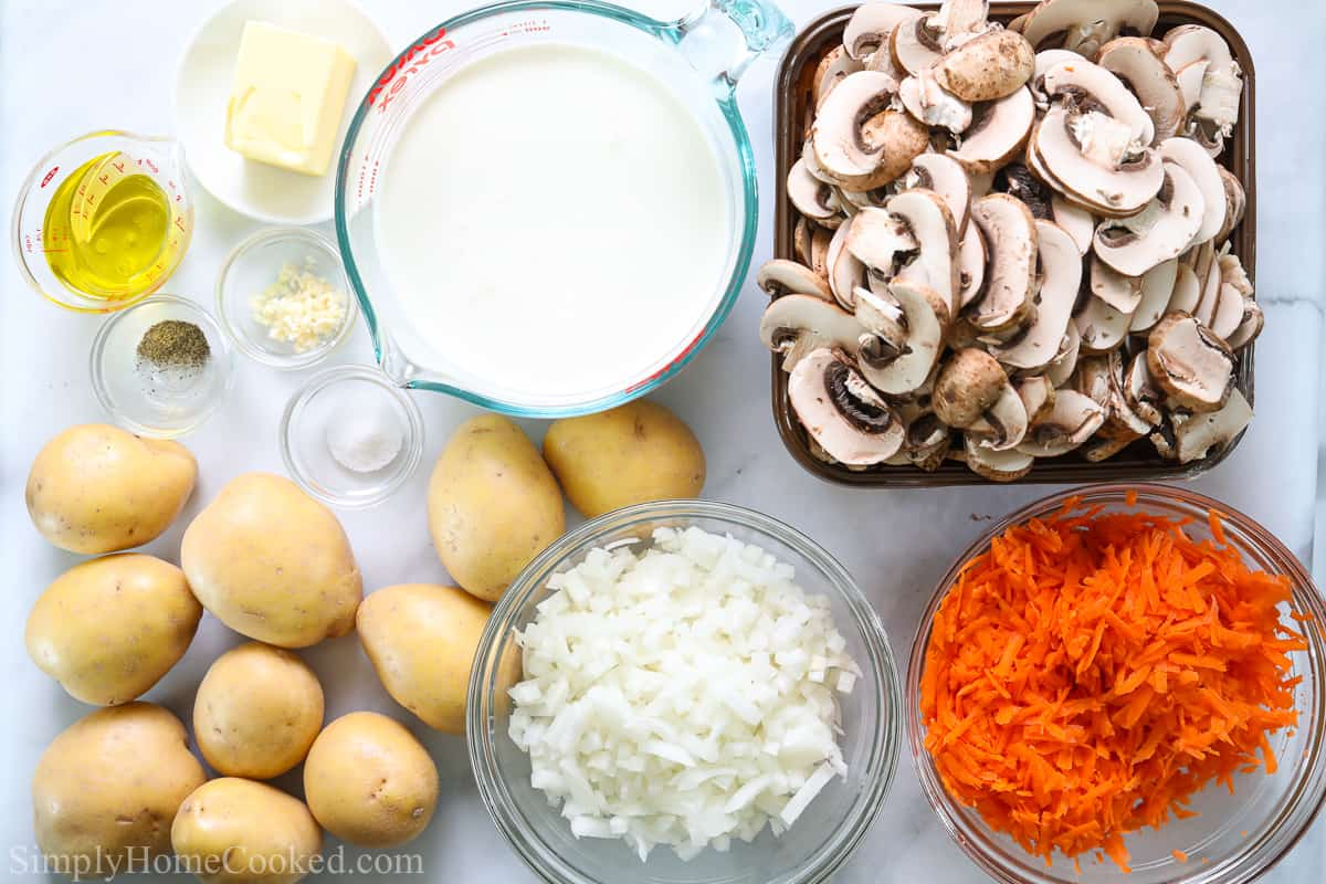 Ingredients for Potatoes with Mushroom Gravy, including potatoes, mushrooms, onion, carrot, garlic, butter, heavy cream, olive oil, salt and pepper.