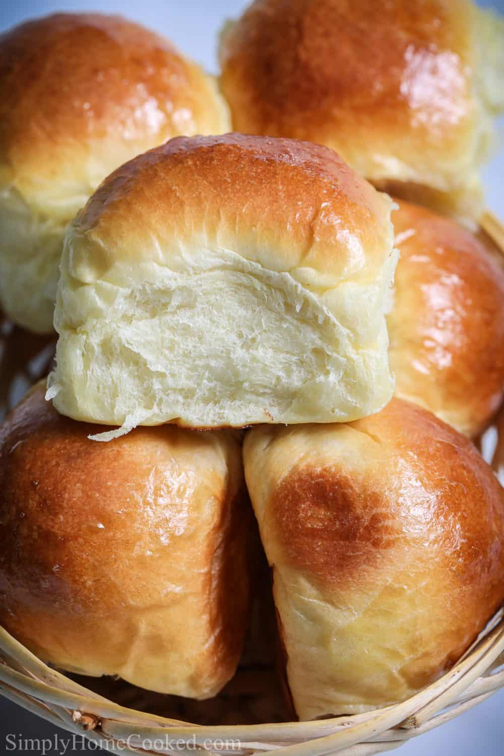Close up of Soft Brioche Dinner Rolls piled on each other.