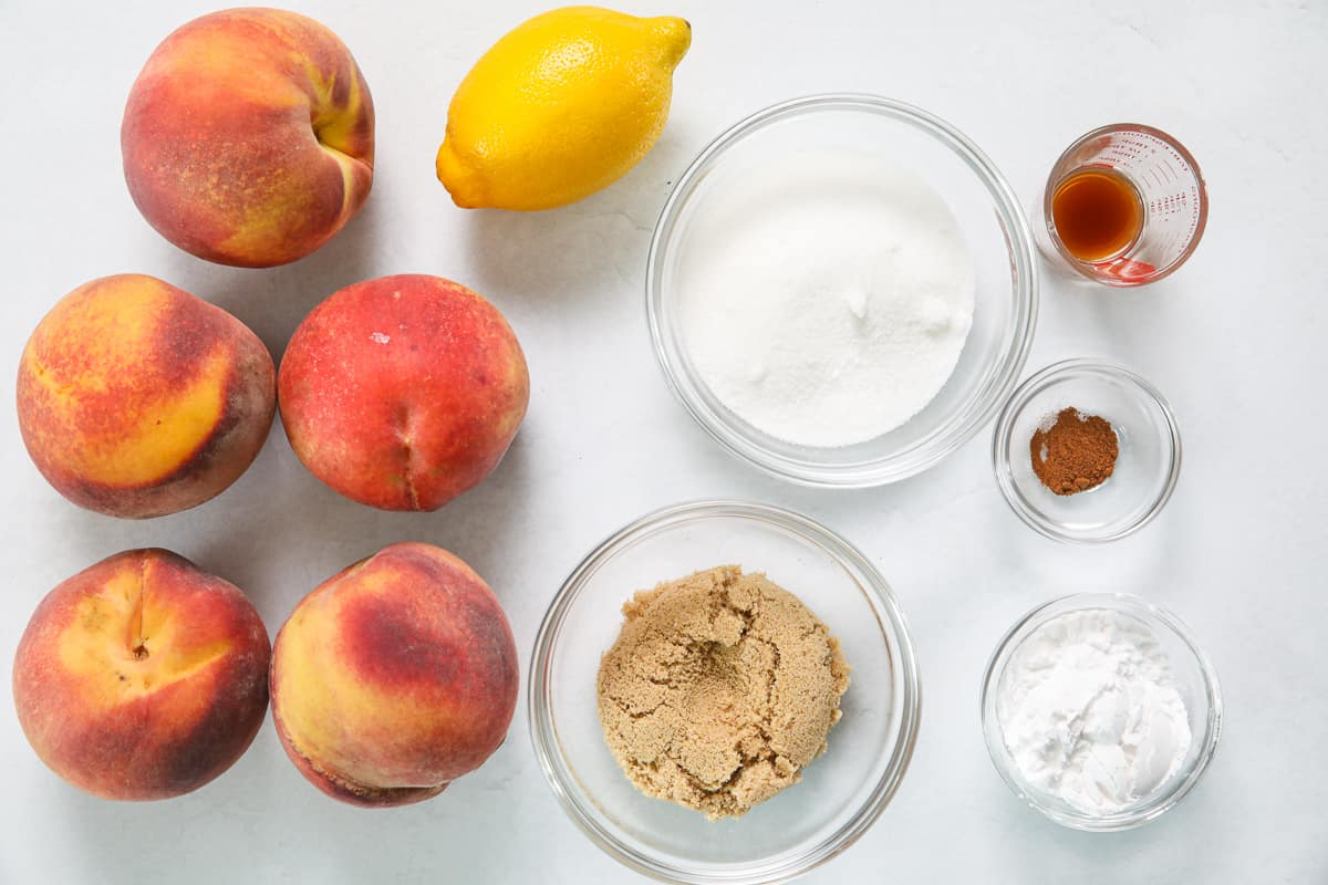 Ingredients for Peach Pie Filling, including peaches, lemon, sugar, brown sugar, vanilla, cinnamon, and corn starch.