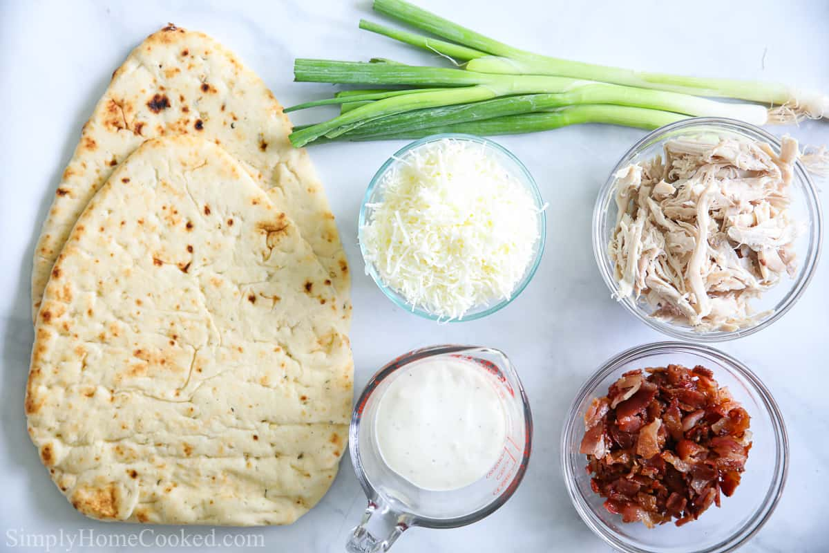an overhead image of ingredients needed to make chicken bacon ranch flatbread pizza