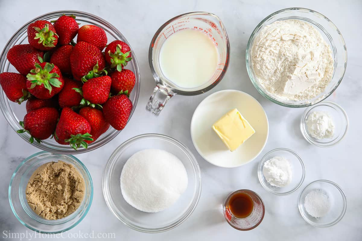 Ingredients for Strawberry Cobbler, including fresh strawberries, flour, sugar, brown sugar, salt, butter, cornstarch, vanilla extract, baking powder, and buttermilk.
