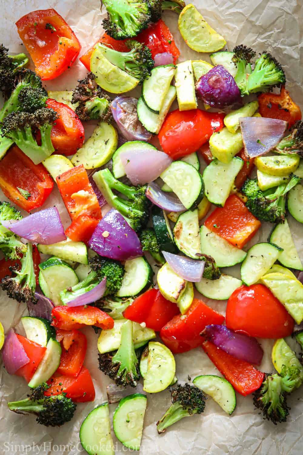 Close up of Roasted Air Fryer Vegetables, including red bell peppers, zucchini, squash, red onion, and broccoli.
