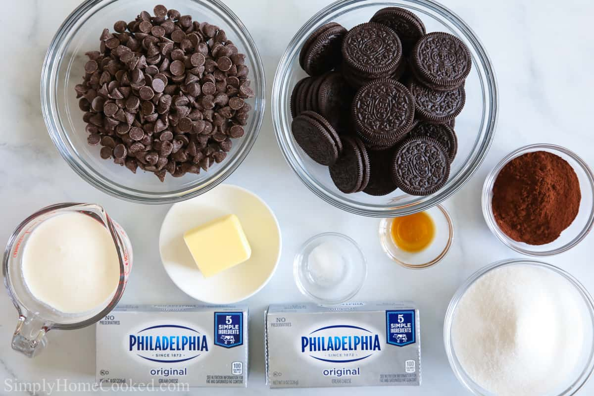 an overhead image of ingredients for no bake chocolate cheesecake bars on a white background