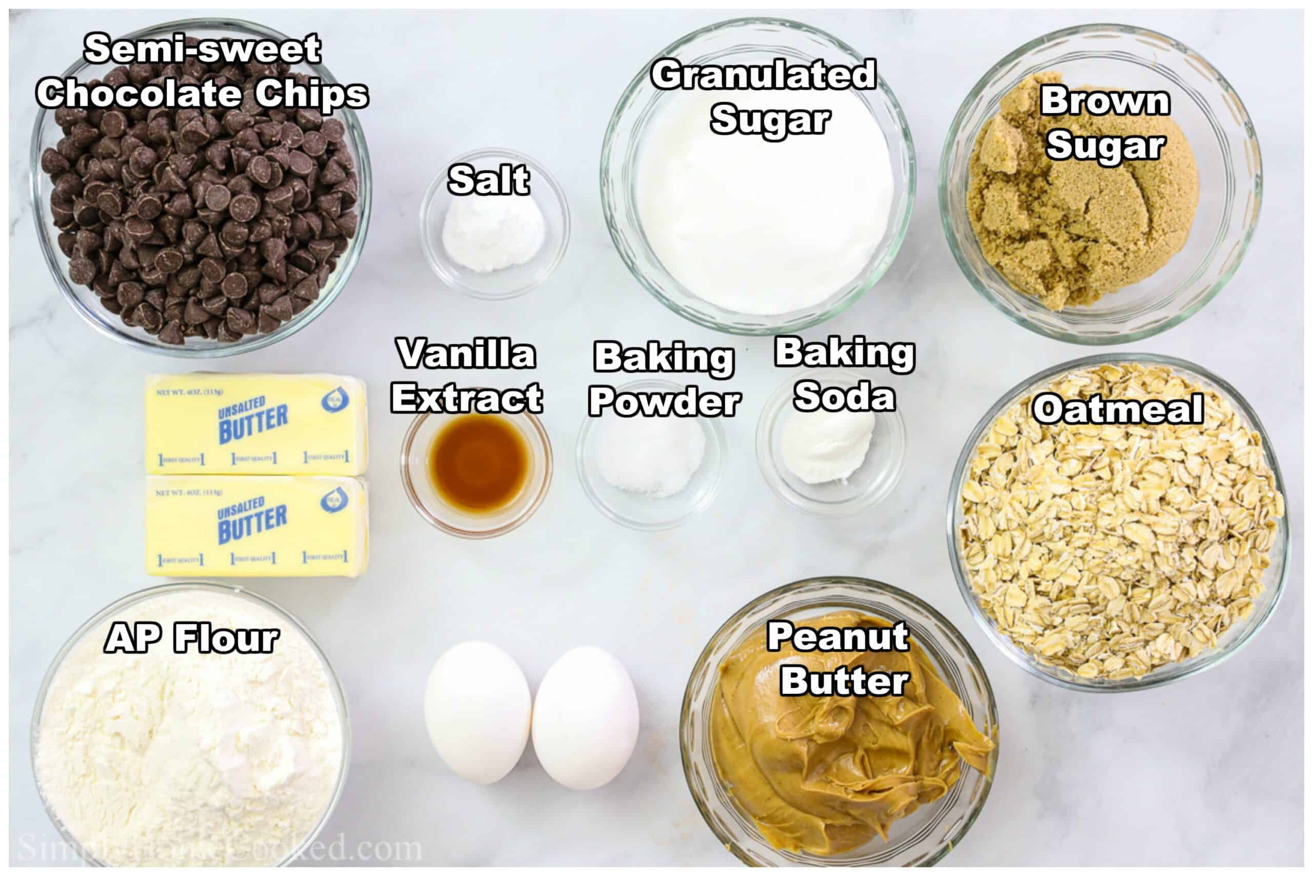 Ingredients for Chewy Peanut Butter Oatmeal Cookies, including flour, granulated sugar, brown sugar, salt, oatmeal, peanut butter, vanilla extract, baking soda, baking powder, butter, and eggs.