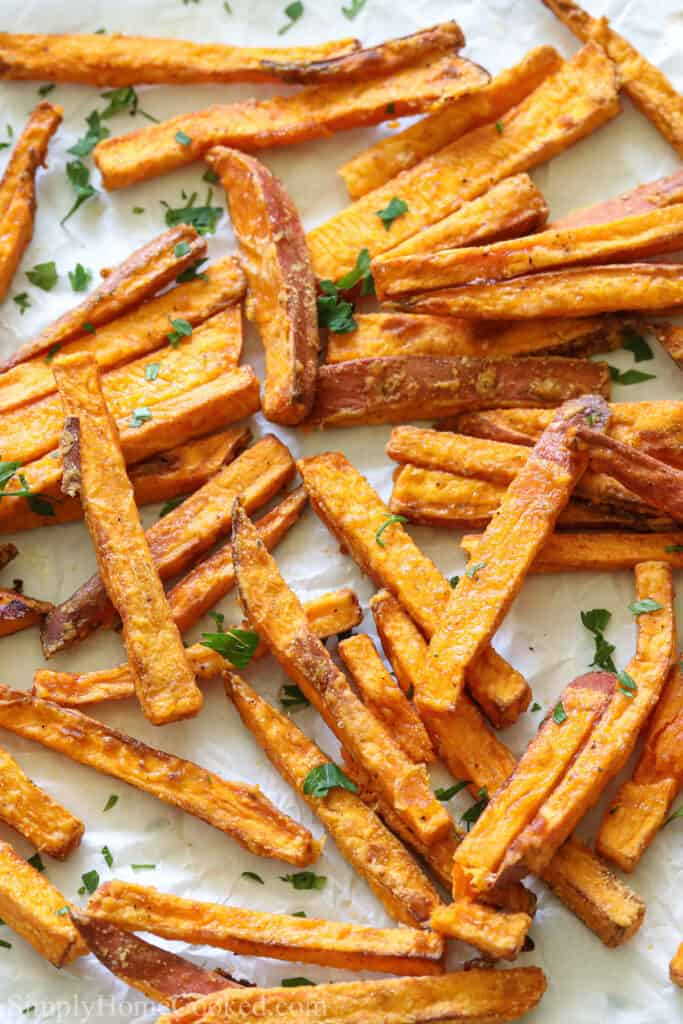 Close up of the Best Air Fryer Sweet Potato Fries with a sprinkling of parsley.