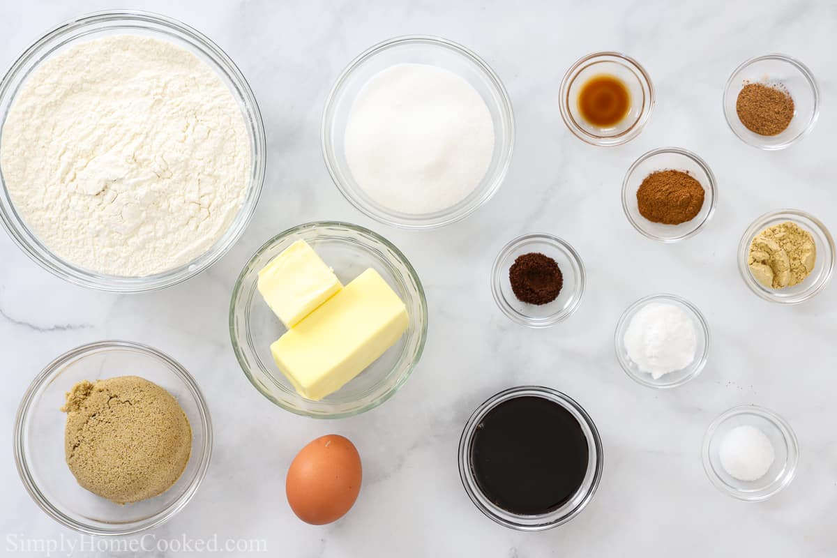 Ingredients for Chewy Ginger Molasses Cookies, including flour, sugar, brown sugar, molasses, butter, egg, vanilla, salt, baking soda, ground cinnamon, nutmeg, ginger, and cloves.