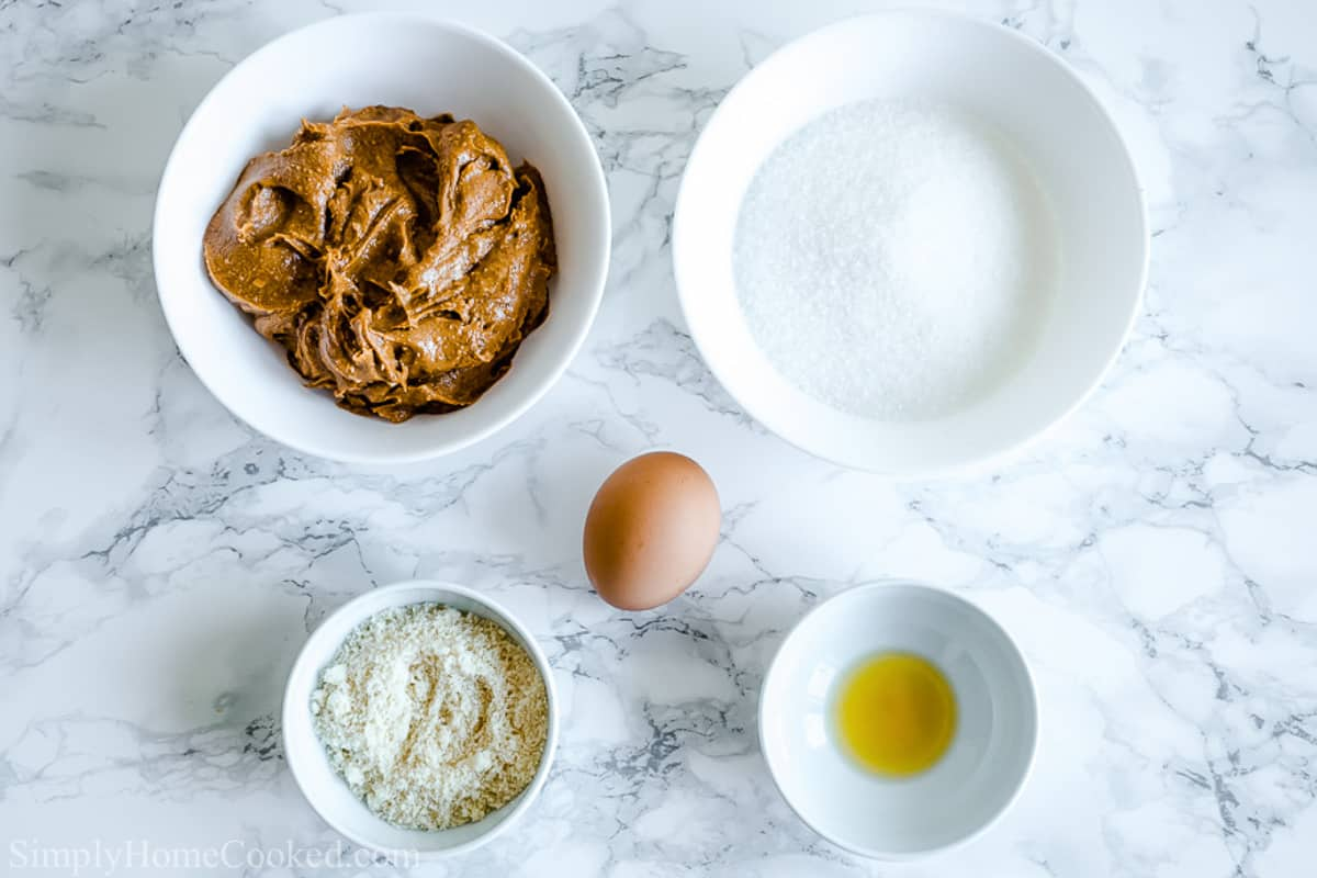 Ingredients for Easy Keto Peanut Butter Cookies, including peanut butter, almond flour, egg, salt, vanilla, and low carb sweetener.