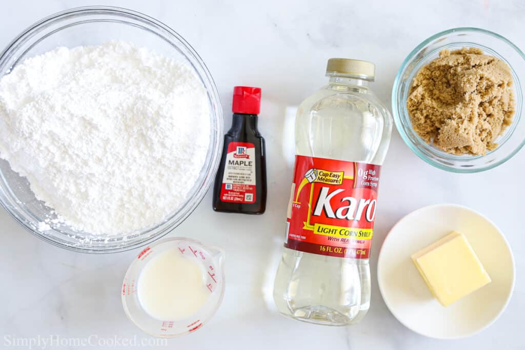 Ingredients for Maple glaze for Maple Donut Bars from Scratch, including powdered sugar, brown sugar, maple extract, corn syrup, butter, and milk.