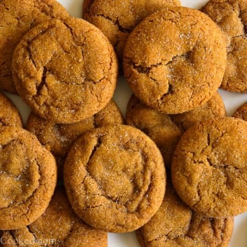 overhead image of chewy ginger molasses cookies overlapping each other