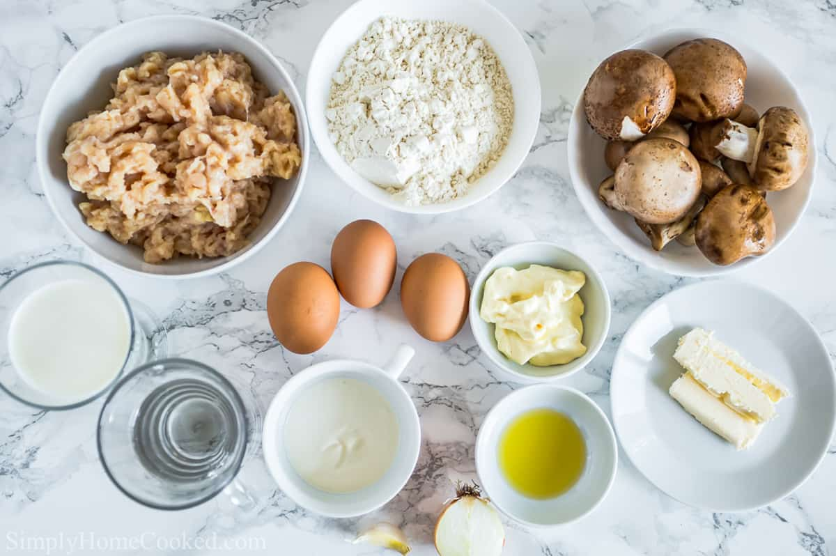 Ingredients for Savory Crepes with Chicken and Mushroom Filling, including ground chicken, baby Bella mushrooms, garlic, onion, flour, milk, water, eggs, olive oil, butter, onion, mayonnaise, and sour cream.