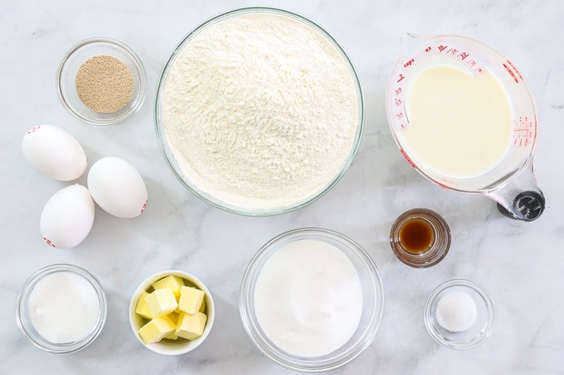 Ingredients for Perfect Sugar Donuts, including flour, sugar, milk, yeast, salt, vanilla, butter, and eggs.
