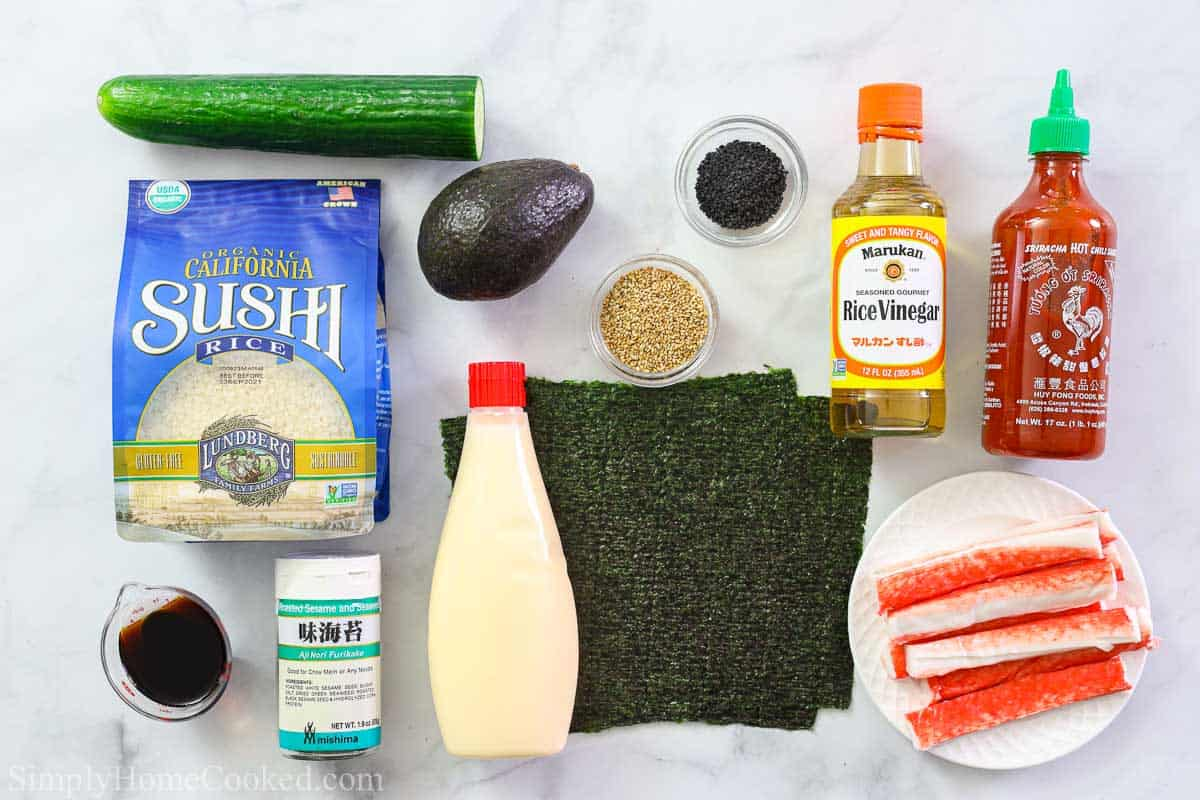 Ingredients for California Sushi Bowls, including sushi rice, English cucumber, avocado, Japanese mayonnaise, soy sauce, furikake, nori sheets, sesame seeds, rice vinegar, sriracha, and crab meat.